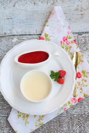 panna: Dessert panna cotta with strawberry sauce Stock Photo