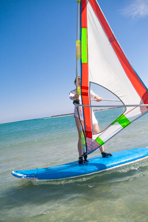 sail board: Girl riding on a board for windsurfing in Egypt, Hurghada.