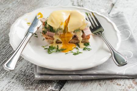 context: eggs Benedict in the context of a hollandaise sauce.