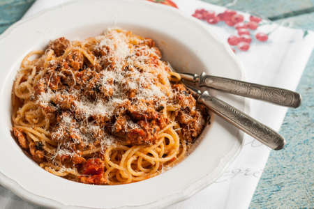 serving of pasta bolognese on a plate.