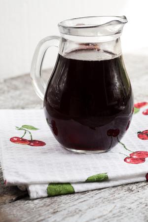 liqueur: jar with cherry brandy liqueur wine