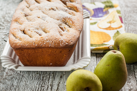 fruitcake: pie fruitcake with pears and powdered sugar.