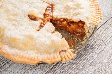 cut off: cut off a piece of American apple pie.
