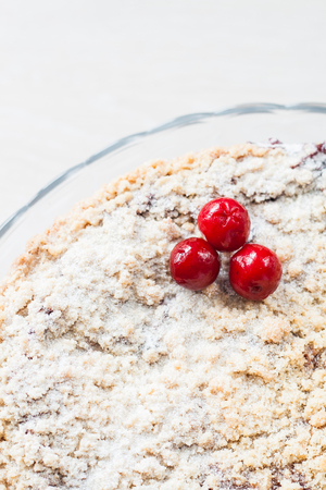 crumb: cake with crumb and cherry, close-up.