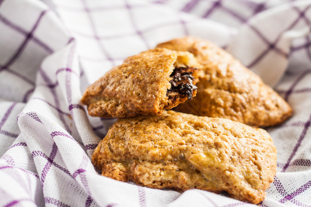 french ethnicity: baked pastry stuffed with chocolate lying on a napkin. Stock Photo