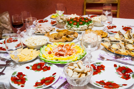 holiday table with dishes, with different dishes, salads.