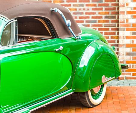 green door: bright green door and fender retro car. Stock Photo