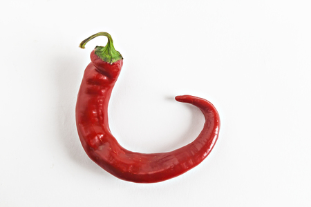 no way out: One pod of red chili peppers isolated.