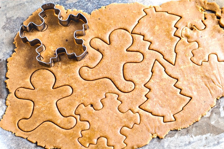 pastry cutters: the stretched raw ginger biscuits and shape of a snowflake. Stock Photo