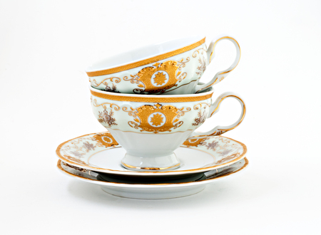 vintage tea set with gold decor isolated.