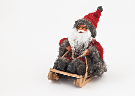 stuff toy: Santa Claus with a beard on a sled tree toy isolated.