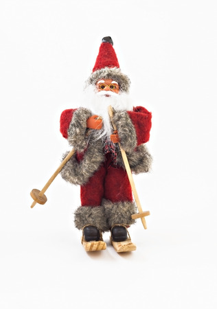 Santa Claus on skis tree toy isolated