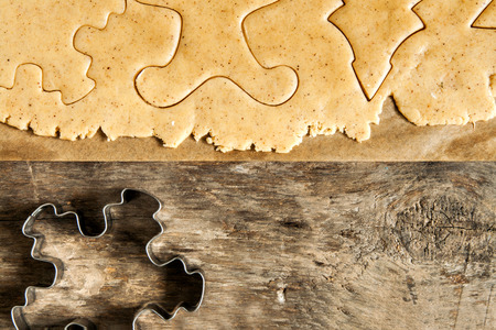 roll out: Roll out the dough cut out Christmas shapes style. Stock Photo