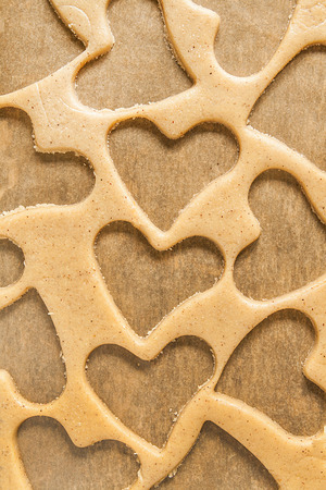 roll out: Roll out the dough to cut out heart shapes. Stock Photo