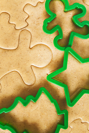 roll out: Roll out the dough cut Christmas figures. Stock Photo