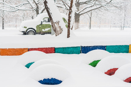 heavy snow: heavy snow fall asleep playground and car.