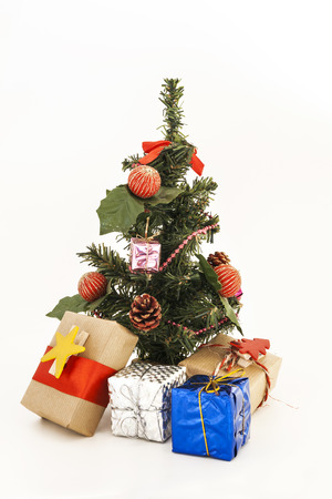 decorated Christmas tree with toys and gifts isolated.