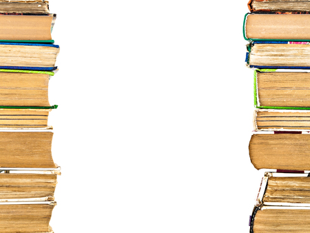 many books standing in a row isolated. Stock Photo