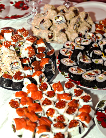 many homemade rolls and sushi close-up. Stock Photo