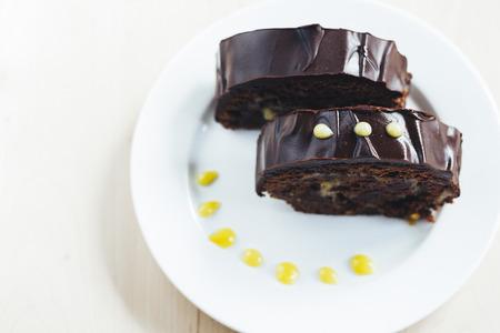 watered: Chocolate roulade with lemon Kurd watered dark chocolate.