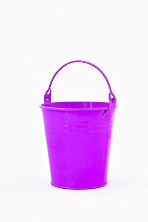 purple metal: purple metal bucket decorative isolated on white background. Stock Photo