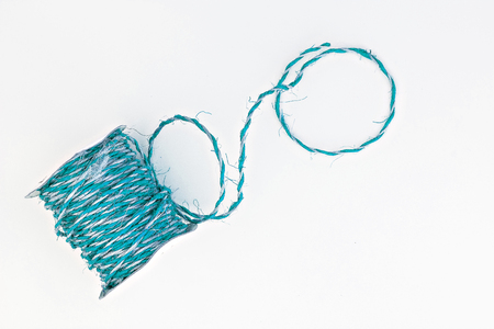 twine: blue twine in a roll isolated.