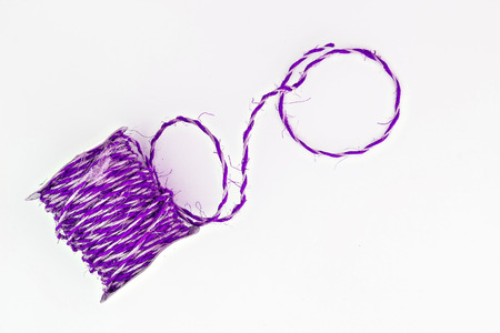 twine: violet twine in a roll isolated.