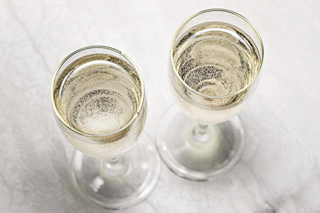 two glasses of champagne in a close-up top view. Stock Photo