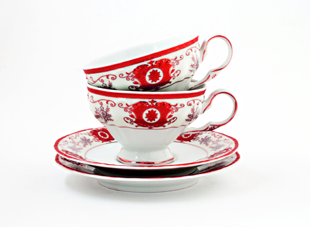 vintage tea set with gold red decor isolated.