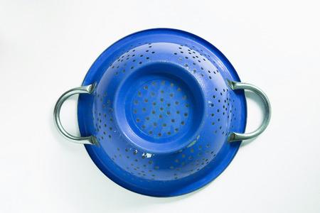 Old blue metal colander sieve.