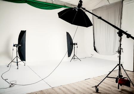Empty a photo studio with lighting equipment. Stock Photo