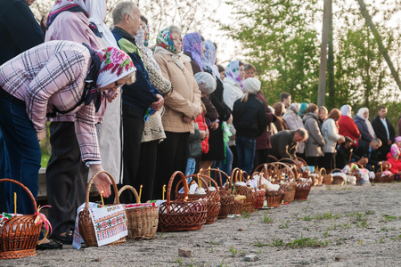 pascha: At Easter many people standing in a row with baskets and candles, waiting for the priest to bless. Ukraina.Fastov. May 1, 2016. Editorial