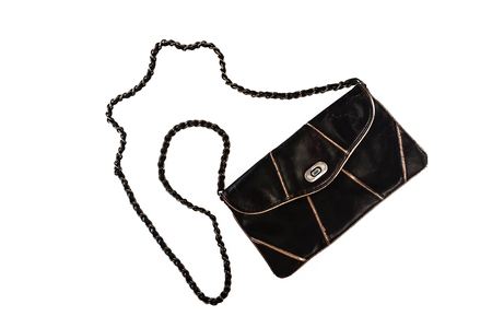 Female clutch bag on a long handle-chain, isolated on a white background.