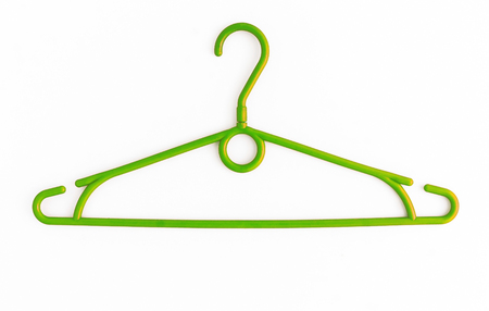 closet: One colored plastic hanger, isolated on white background, close-up.