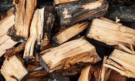 outdoor fireplace: Background of many logs, firewood, close-up, top view.