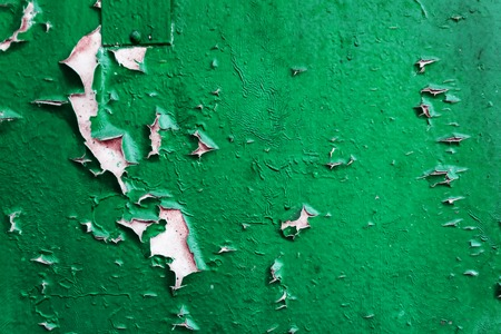 Colored concrete background with peeling old paint.