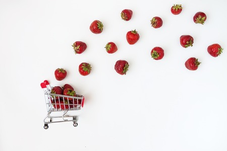 Fresh juicy strawberries in a food cart, isolated on a white background. Stock Photo
