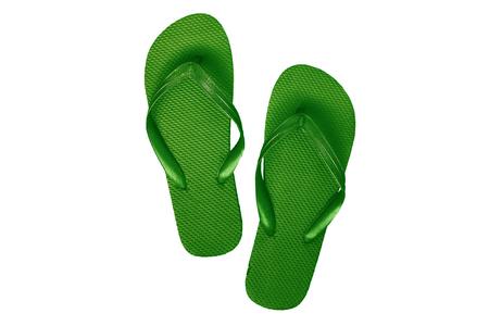 Green-turquoise rubber flip flops, isolated on white background. 免版税图像