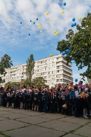 first year student: Ukraine.Kiev - September 1, 2016. First-graders and other students on the line near the school.
