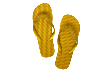 Yellow rubber flip flops, isolated on white background.