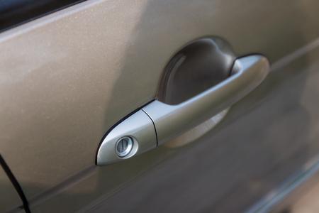 door handle: handle on car door, close-up.