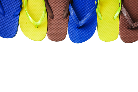 flip flops: Several pairs of multi-colored rubber flip-flops exhibited in a row, isolated.
