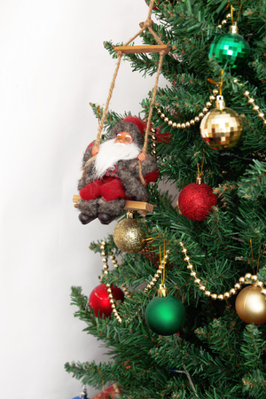 xmass: Christmas tree with toys and Santa Claus isolated on white background.