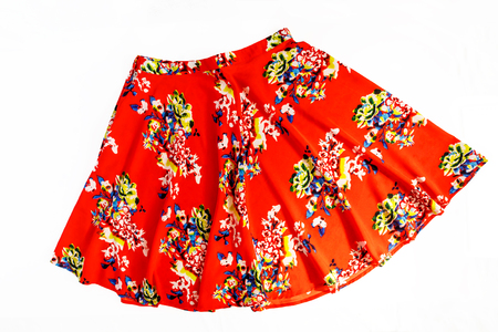 Bright colored fashionable summer floral skirt for women / girl, isolated on white / Stylish summer flower skirt isolated on white background.