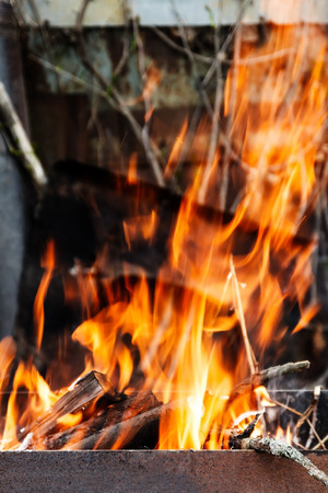 the hearth burn firewood and branches for coal. Stock Photo