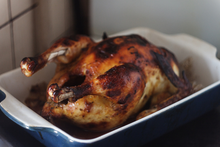appetizing baked chicken with golden roasted crust cooked in the oven.