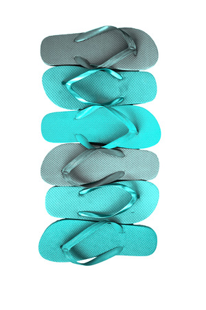 Several pairs of multi-colored rubber flip-flops exhibited in a row, isolated.