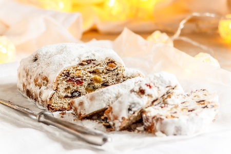 A close-up shot of traditional Christmas stollen fruit cake. Sweet gift for Christmas. Selective focus