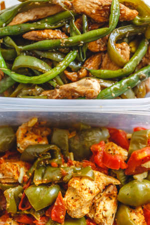 Chicken stew and various vegetables-pepper, tomato, zucchini, asparagus beans in plastic vessels for storage in the refrigerator or freeze