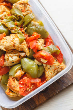 Chicken stew and various vegetables-pepper, tomato, zucchini in plastic vessels for storage in the refrigerator or freeze Фото со стока